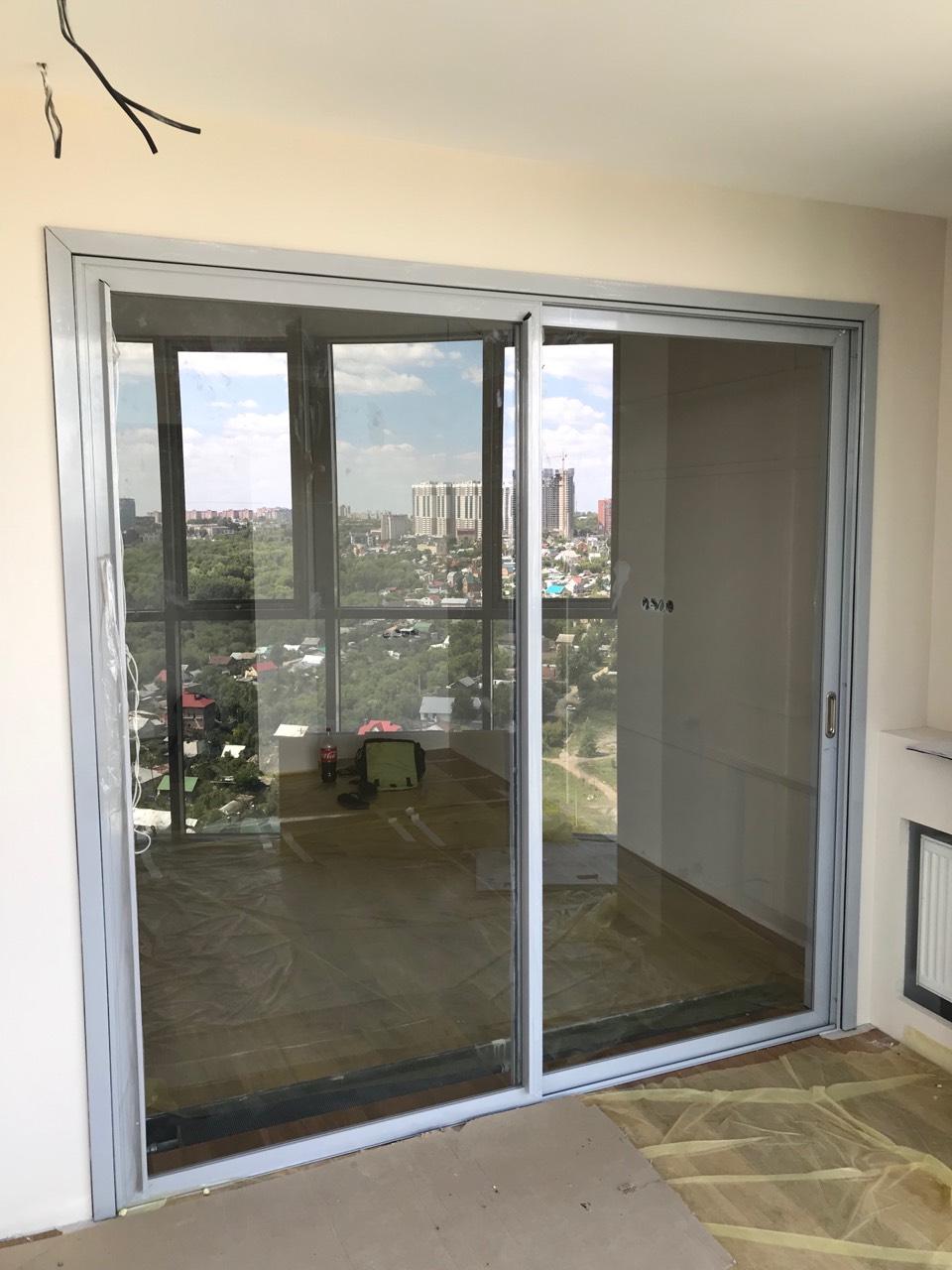 Завершены работы по монтажу алюминиевых конструкций в жилую квартиру